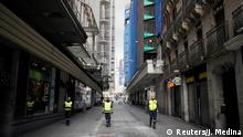 Members of the Military Emergency Unit (UME) patrol during partial lockdown as part of a 15-day state of emergency to combat the coronavirus disease outbreak in Madrid
