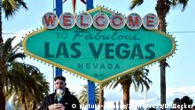 March 16, 2020 - Las Vegas, Nevada, U.S. - In light of the coronavirus pandemic tourists continue to stand in line waiting their turn to photograph themselves in front of the Fabulous Las Vegas sign, set with a green overlay to honor Saint Patrick's Day on March 16, 2020, in Las Vegas For most people, COVID-19 causes only mild or moderate symptoms, such as fever and cough. For some, especially older adults and people with existing health problems, it can cause more severe illness, including pneumonia. (Credit Image: © David Becker/ZUMA Wire |