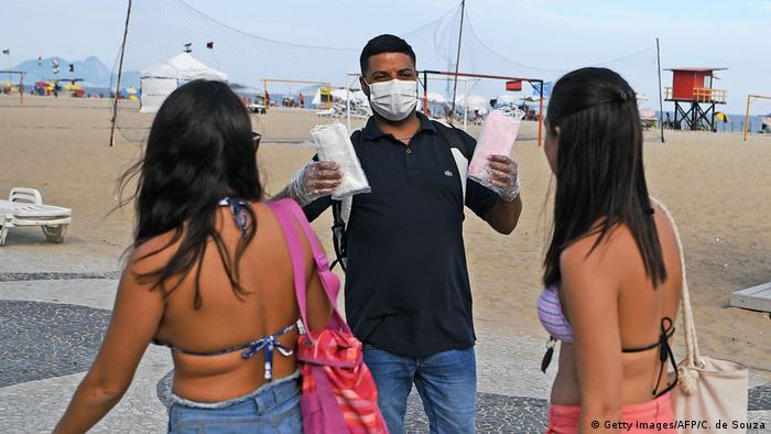 A street vendor sells face masks on Copacobana beach in Rio de Janeiro
