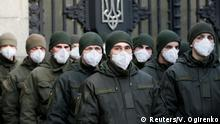 Members of the National Guard of Ukraine wearing protective face masks stand guard in front of the Ukrainian parliament building amid coronavirus (COVID-19) concerns in Kiev, Ukraine March 17, 2020. REUTERS/Valentyn Ogirenko TPX IMAGES OF THE DAY