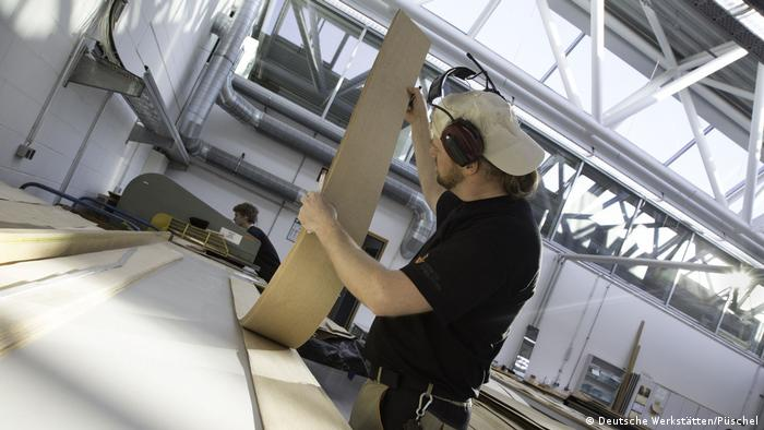 An employee working at a DWH production facility