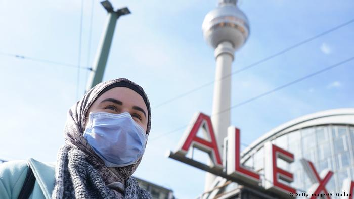 A person at Berlin's Alexanderplatz wearing a face mask