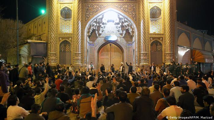 People gather at the shrine of Fatima Masumeh in Qom, Iran, despite the coronavirus crisis (Getty Images/AFP/M. Marizad)