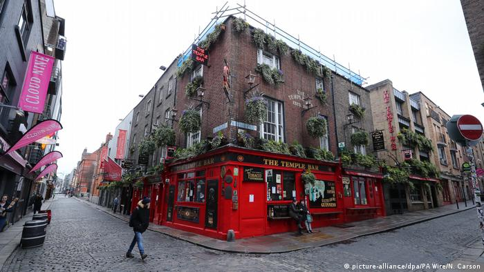 A passer by goes by a closed pub on St. Patrick's Day in Dublin