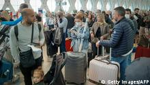 Passengers wait for their flights at the Marrakesh Airport on March 15, 2020. - Several special flights departed Morocco taking thousands of stranded Europeans home as the kingdom announced it was suspending all regular air traffic due to the coronavirus, authorities and airports said. Morocco said it had decided to suspend all international commercial flights until further notice, extending a ban that had previously been applied to around 30 nations, including Italy, France and Spain. (Photo by - / AFP) (Photo by -/AFP via Getty Images)