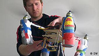 A lab assistant displays the quadrocopter