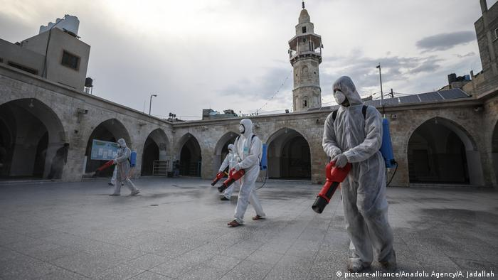 Officials carry out disinfection works as a precaution against the coronavirus (COVID-19) at Great Mosque of Gaza in Israeli blockaded Gaza City, Gaza
