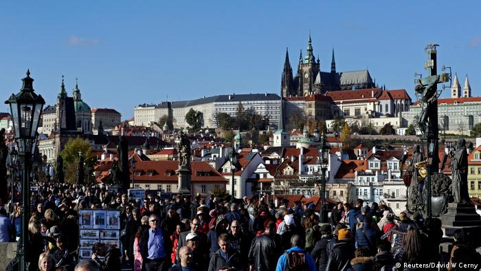 Czech Republic | Prague | Tourists walk in droves over the medieval Charles Bridge in 2019 (Reuters/David W Cerny)