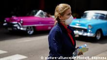 A woman wears a mask as a precaution against the spread of the new coronavirus at the Jose Marti International Airport in Havana, Cuba, Thursday, March 12, 2020, after the government announced its first new virus cases. The vast majority of people recover from the new virus. (AP Photo/Ramon Espinosa) |