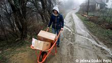 Geronto host Mikica Todorovic carries food to the elderly in the village of Radosin, near Babusnica, Serbia, 18.03.2020.