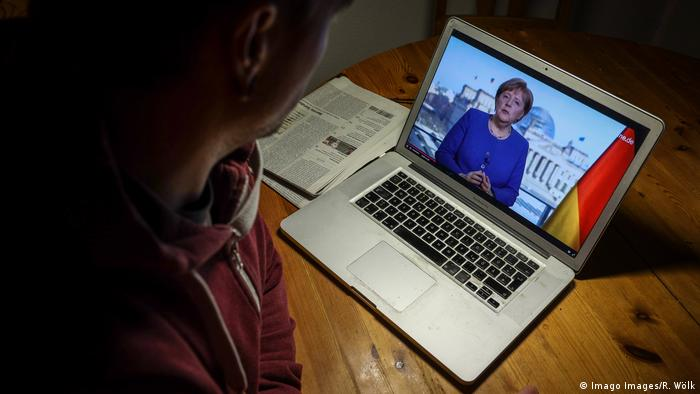 A man watched Merkel's address on his laptop
