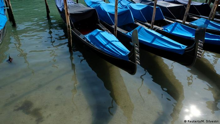 Gondolas on the clear waters of Venice canals