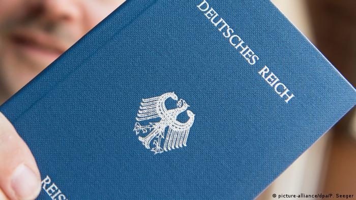 A close-up photo of a Reichsbürger counterfeit passport, for the long-defunct state once known as the Deutsches Reich, or German Empire.