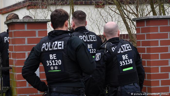 German police gather outside a property