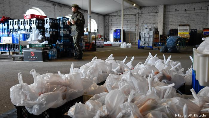 Soldiers of the German armed forces Bundeswehr prepare food supply for truck drivers