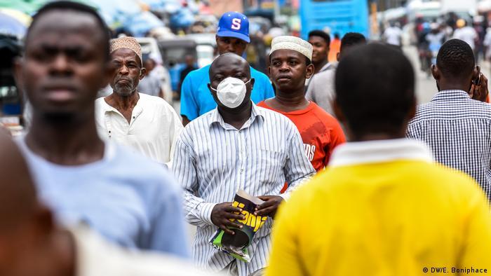 Tanzanians walking on a street in Dar es Salaam.