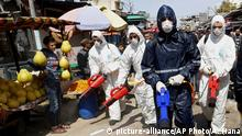 Workers wearing protective gear spray disinfectant as a precaution against the coronavirus, at the main market in Gaza City, Thursday, March 19, 2020. The Middle East has some 20,000 cases of the virus, with most cases in Iran or linked to travel from Iran. The vast majority of people recover from COVID-19. (AP Photo/Adel Hana) |