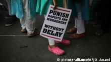 FILE - In this April 15, 2018, file photo, an Indian protester stands with a placard during a protest against two recently reported rape cases as they gather near the Indian parliament in New Delhi, India. Four men sentenced for capital punishment for the 2012 gang-rape of a 23-year-old physiotherapy student on a moving bus in New Delhi have been executed. The men were hanged Friday morning, March 20, 2020, at Tihar Jail in New Delhi. (AP Photo/Oinam Anand, File) |