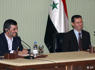 Syrian President Bashar Assad, right, laughs during a press conference with his Iranian counterpart Mahmoud Ahmadinejad, left, in Damascus, Syria, Thursday, Feb. 25, 2010. The United States should pack up and leave the Middle East and stay out of regional affairs, Iran's president said Thursday during a visit to Damascus that follows a string of U.S. efforts to break up Syria's 30-year alliance with Tehran. (AP Photo/Bassem Tellawi)