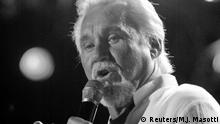 FILE PHOTO: Country artist Kenny Rogers sings at the Coliseum during the Country Music Association Music Festival in Nashville, Tennessee U.S., June 11, 2005. REUTERS/M. J. Masotti, Jr./File Photo