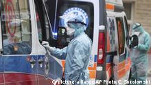 Ambulance crews disinfect their ambulances in Warsaw