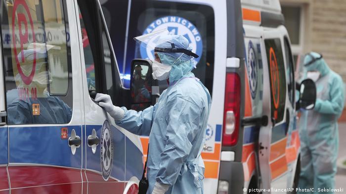 Ambulance crews disinfect their ambulances in Warsaw