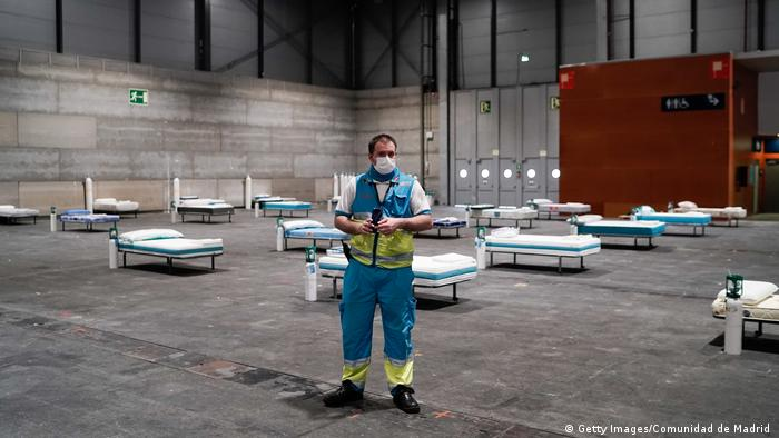 A health care worker at a yet-empty emergency field hospital in Madrid
