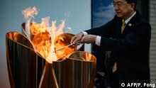 22.03.2020 *** The Tokyo 2020 Olympic flame is displayed outside Miyako railway station, Iwate prefecture on March 22, 2020, after arriving from Greece (Photo by Philip FONG / AFP)