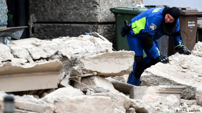 A police officer moving rubble after an earthquake in Zagreb on Sunday (AFP/D. Lovrovic)