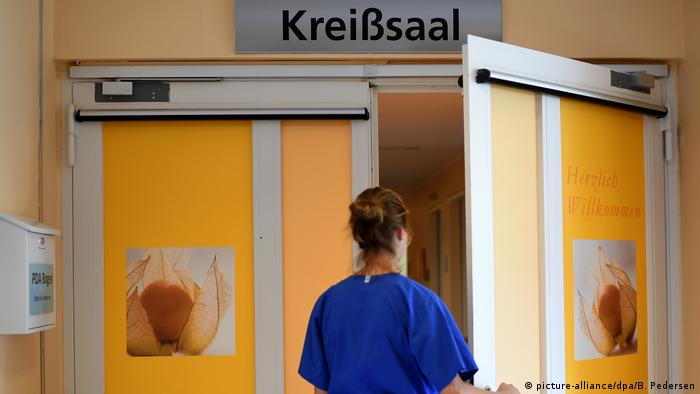 Woman walking into delivery room