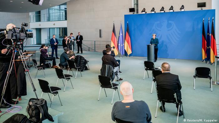 German Chancellor Angela Merkel gives a media statement on social distancing measures
