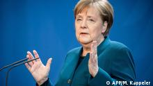 German Chancellor Angela Merkel makes a press statement on the spread of the new coronavirus COVID-19 at the Chancellery, in Berlin on March 22, 2020. (Photo by Michael Kappeler / POOL / AFP)