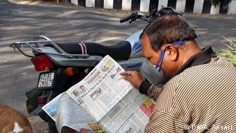 Мужчина в маске в Нью-Дели