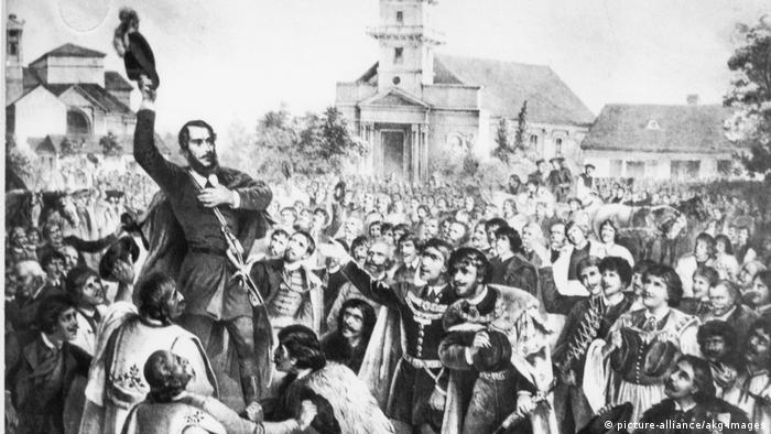 Black and white drawing of Sandor Petöfi giving a speech in front of an agitated crowd (picture-alliance/akg-images)