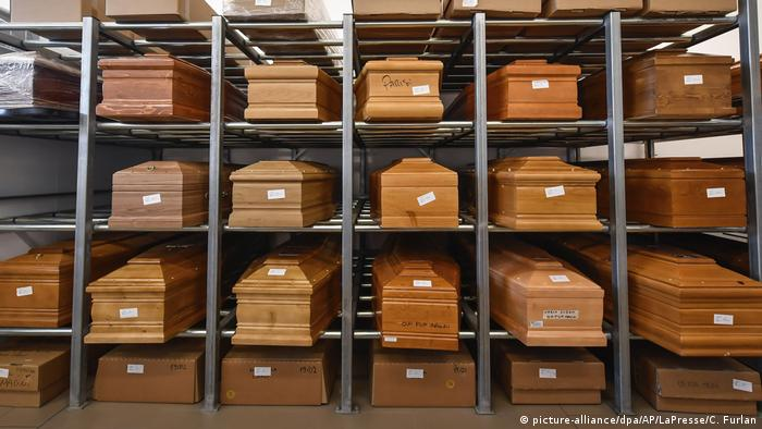 Coffins stacked at a crematorium in Piacenza, Italy