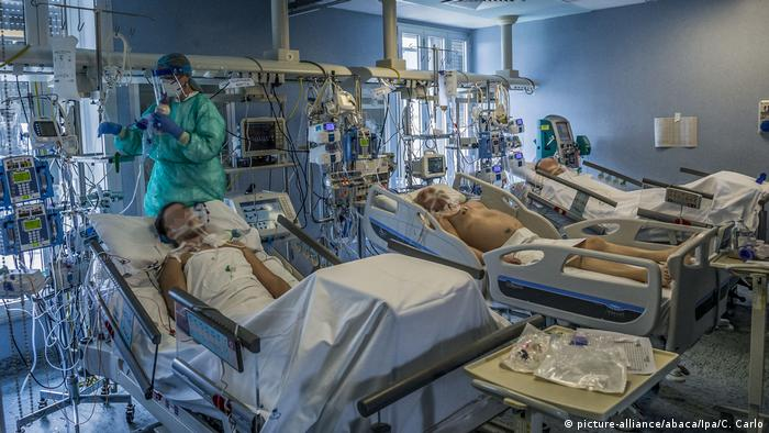 Health care workers treat the most serious patients infected with the COVID-19 virus at Cremona hospital intensive care unit in Cremona, south east of Milan