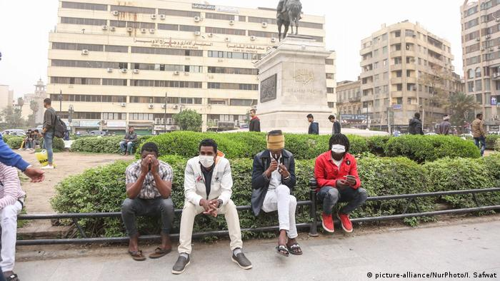 People in Cairo wear masks and gloves against coronavirus