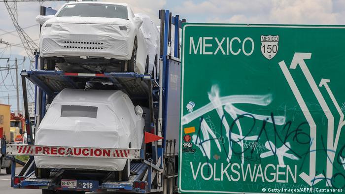 Trucks drive near the Volkswagen plant in Puebla