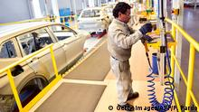Employees work on the assembly line of the Tiguan model, at the Volkswagen car plant in Puebla, central Mexico, on March 16, 2018. / AFP PHOTO / Pedro PARDO (Photo credit should read PEDRO PARDO/AFP via Getty Images)