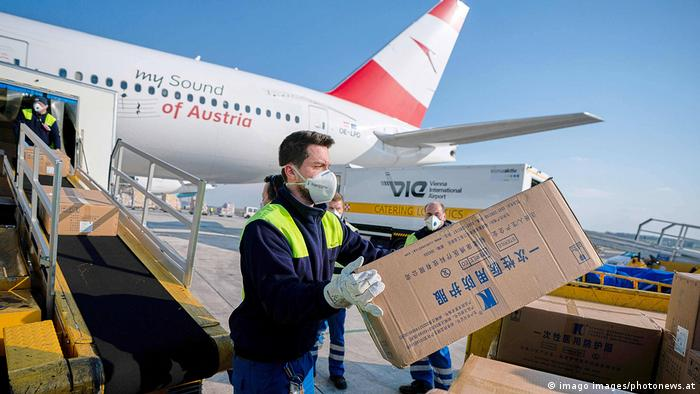 International aid workers deliver material in Italy off a plane