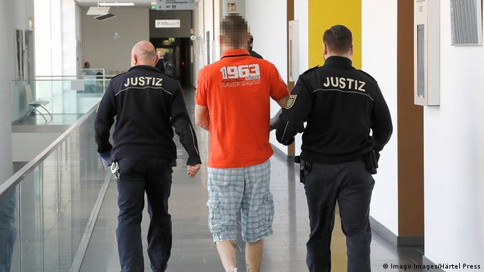 Revolution Chemnitz defendant is led away by justice officers