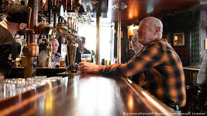 People sit in bar in Stockholm, Sweden