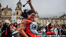 Musicians perform during a protest at Bolivar square in Bogota, Colombia, on September 20, 2019, in the framework of the Friday for the planet global demo against climate change. - A Youth Climate Summit will take place at the United Nations on Saturday. UN Secretary-General Antonio Guterres will then host an emergency summit on Monday in which he will urge world leaders to raise their commitments made in the 2015 Paris climate accord. (Photo by JUAN BARRETO / AFP) (Photo credit should read JUAN BARRETO/AFP via Getty Images)