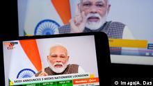 March 24, 2020, Kolkata, West Bengal, India: In this photo illustration Indian Prime Minister, Narendra Modi seen on a smartphone screen announcing complete lockdown for another 21 days as a preventive measure to control the outbreak of Coronavirus..India Reported 511 infected case & 10 Death as on 24th Mar due to Coronavirus attack. Kolkata India - ZUMAs197 20200324zaas197108 Copyright: xAvishekxDasx