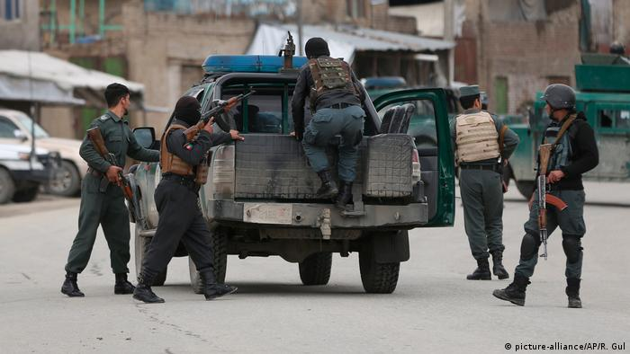 Afghan personnel arrive at the site of an attack in Kabul, Afghanistan