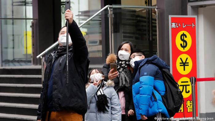 A person taking a family selfie in Seoul