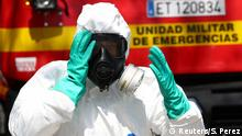 A member of Emergency Military Unit (UME) prepares to disinfect in a special facility for psychically disabled people during the coronavirus disease (COVID-19) outbreak in Getafe, Spain March 25, 2020. REUTERS/Sergio Perez