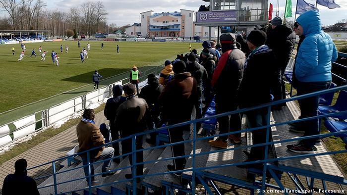 Fans attend a Belarussian cup match on March 22