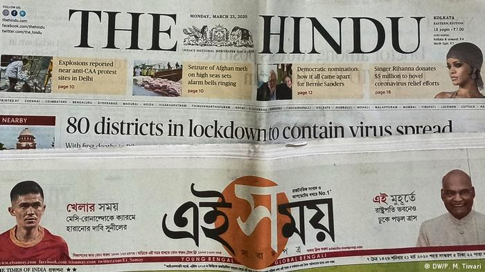 Two Indian newspapers with headlines