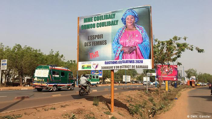 A campaign billboard on a busy street in Bamako, Mali